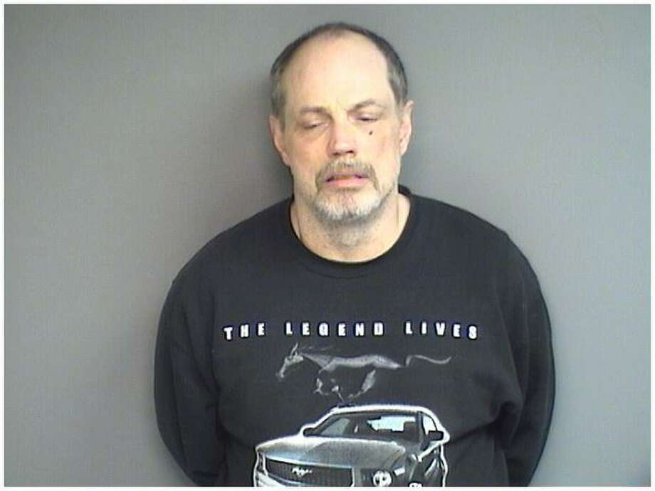 Stuart Dunham, 57, of Woodbury, was charged with possession of an hallucinogen, possession with intent to sell and possession of drug paraphernalia after he was arrested with crystal methamphetamine in Stamford on Wednesday. Photo: Stamford Police / Contributed
