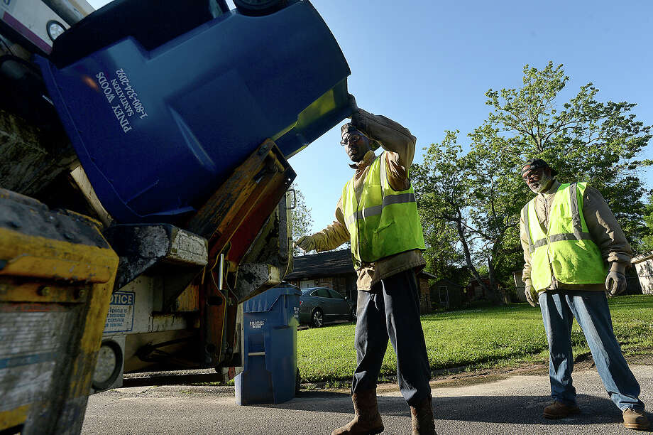 Piney Woods Sanitation workers Reginald Gibson (right) and Rockwell Hunt work their route through a neighborhood in Silsbee. Garbage collecting is the fifth deadliest job in the U.S. The excess debris and health risks due to Tropical Storm Harvey have added to the hazards the job poses for area sanitation workers. Photo taken Wednesday, April 11, 2018 Kim Brent/The Enterprise Photo: Kim Brent / BEN