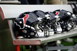Houston Texans helmets sit on the bench before an NFL football game against the Cleveland Browns on Sunday, Oct. 15, 2017, in Houston. (AP Photo/Eric Gay)