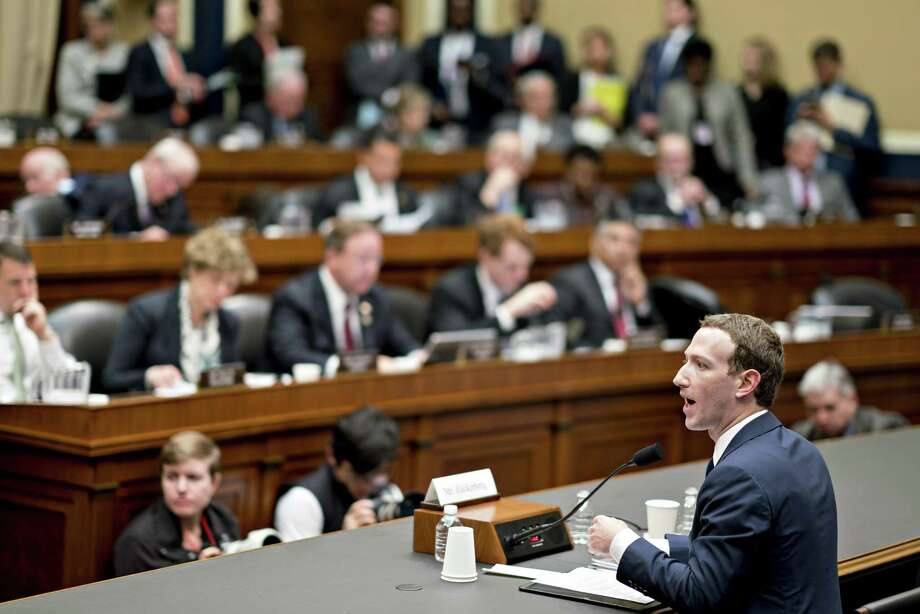 Mark Zuckerberg, chief executive officer and founder of Facebook Inc., speaks during a House Energy and Commerce Committee hearing in Washington, D.C., U.S., on Wednesday. Zuckerberg, under stern questioning by U.S. House lawmakers about the social network's privacy practices, said Facebook does collect digital information on consumers who aren't registered as users, acknowledging something that has been reported but not publicly spelled out by the company. Photo: Andrew Harrer /Bloomberg / © 2018 Bloomberg Finance LP