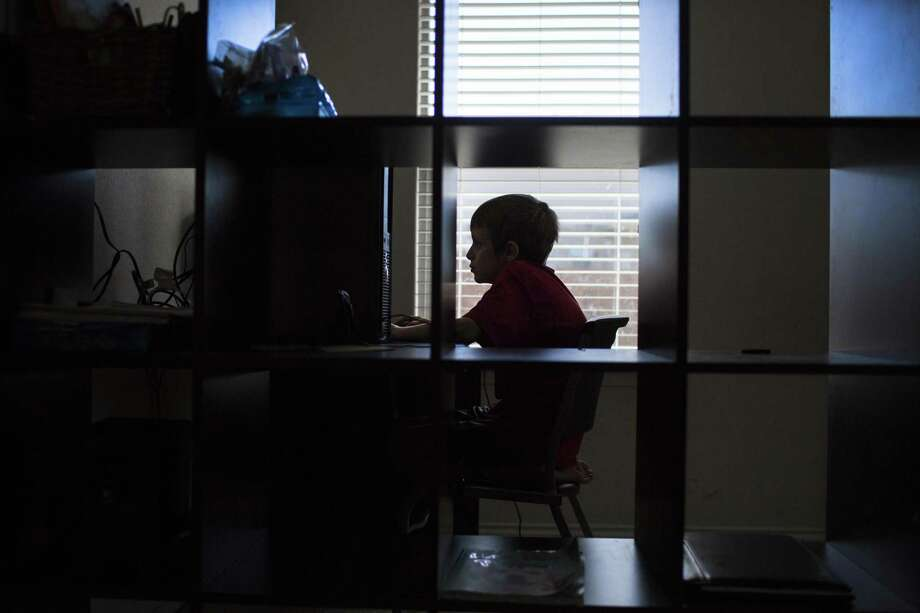 A child with autism works on his desktop computer at home. Online learning is an option for parents of children on the autism spectrum. Photo: Marie D. De Jesus /Houston Chronicle / © 2016 Houston Chronicle