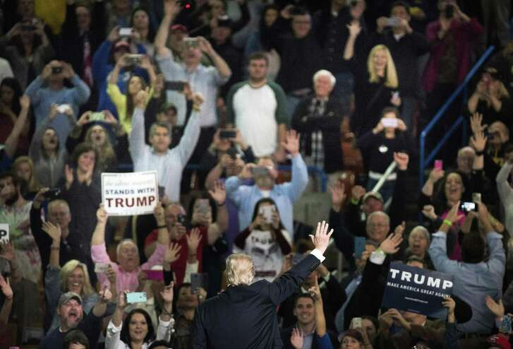 Donald Trump, then a presidential candidate, waves to supporters at a campaign rally in Charleston, W. Va., on May 5, 2016. Anti-Trumpers have not persuaded his followers to abandon him. His approval rating remains at a consistent 40 percent.