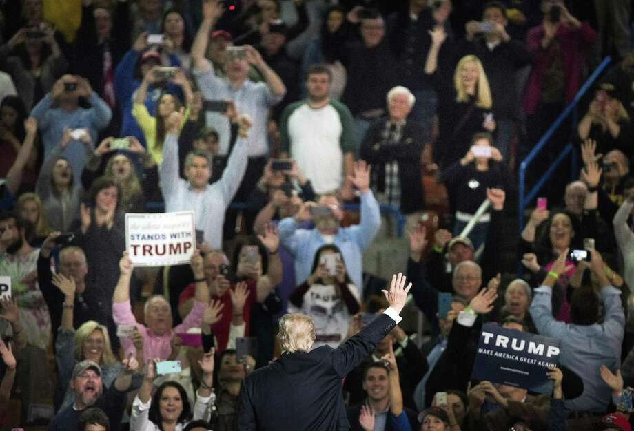 Donald Trump, then a presidential candidate, waves to supporters at a campaign rally in Charleston, W. Va., on May 5, 2016. Anti-Trumpers have not persuaded his followers to abandon him. His approval rating remains at a consistent 40 percent. Photo: TY WRIGHT /NYT / NYTNS