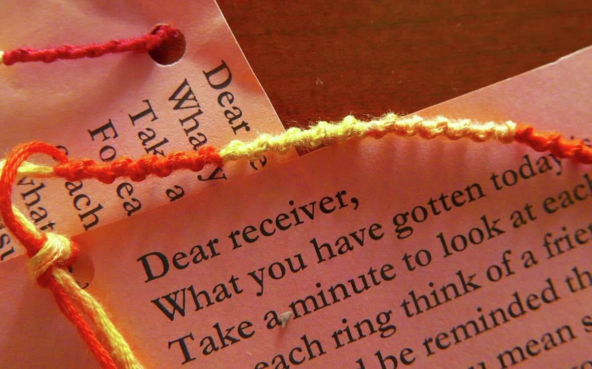 Students at Churchill High School weave bracelets like these for the Threads of Love program. They attach affirming notes to them and then give them to fellow students to provide extra encouragement.