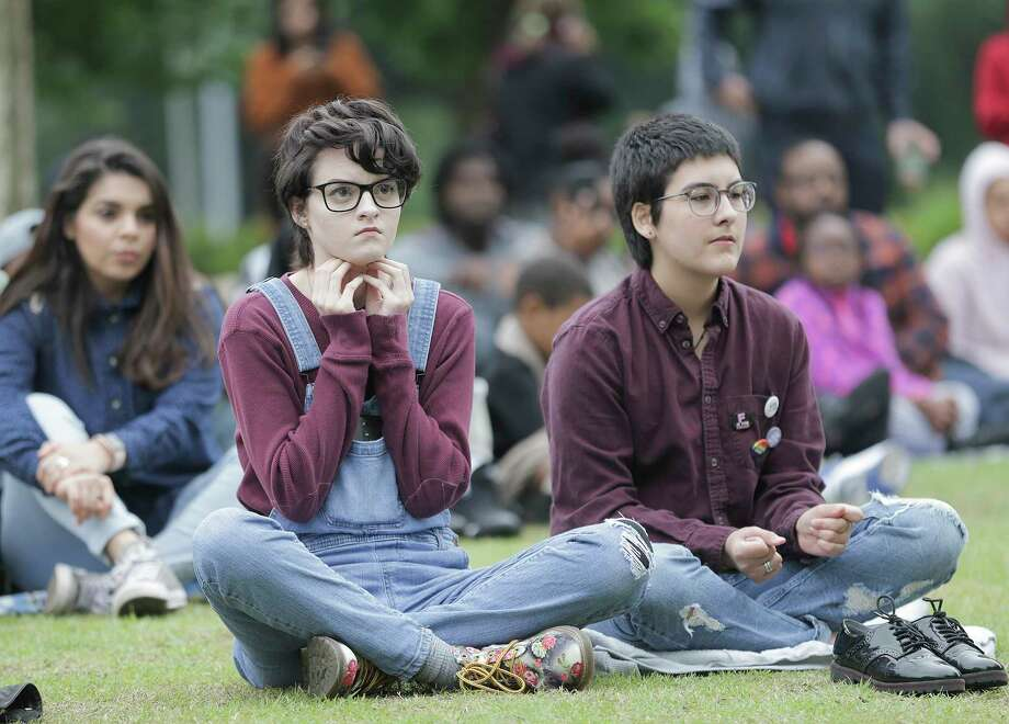At Discovery Green, audience members listen during the Space City Grand Slam. Photo: Elizabeth Conley, Houston Chronicle / © 2018 Houston Chronicle