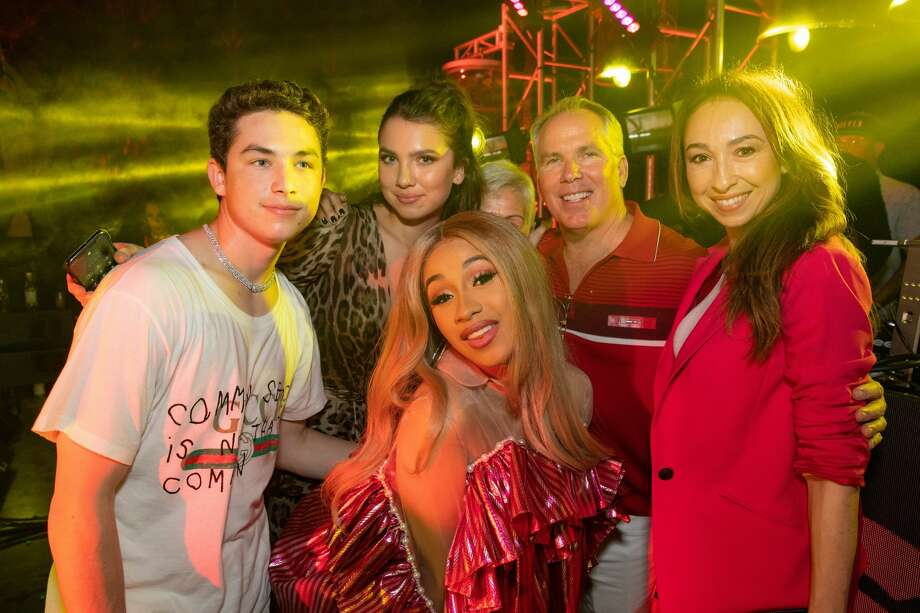 Thomas Henry Jr. (left), Maya Henry (center), Thomas J. Henry (center) and Azteca Henry (right) pose with rapper Cardi B (center) at San Antonio attorney Thomas J. Henry's 56th birthday in Miami, Florida in April 2018. Photo: ARAM HOVSEPIAN