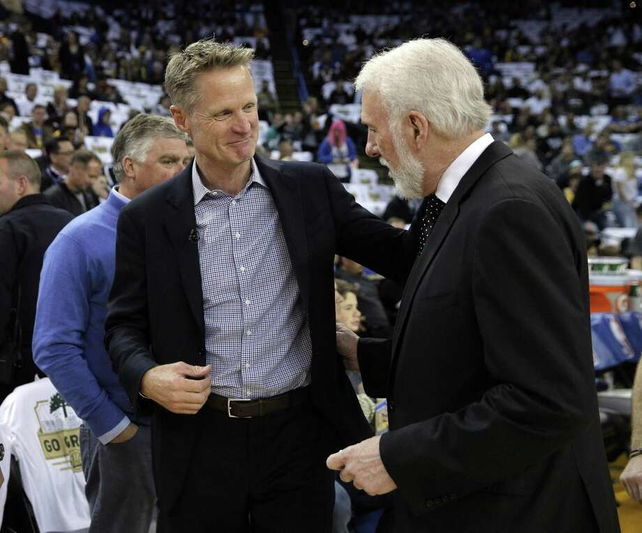 Former Spur Steve Kerr is on his way to the Golden State Warrior's 5th consecutive NBA Finals appearance, but not before catching up with his former coach, Gregg Popovich. Photo: Carlos Avila Gonzalez, Staff Photographer / The Chronicle / Carlos Avila Gonzalez - San Francisco Chronicle