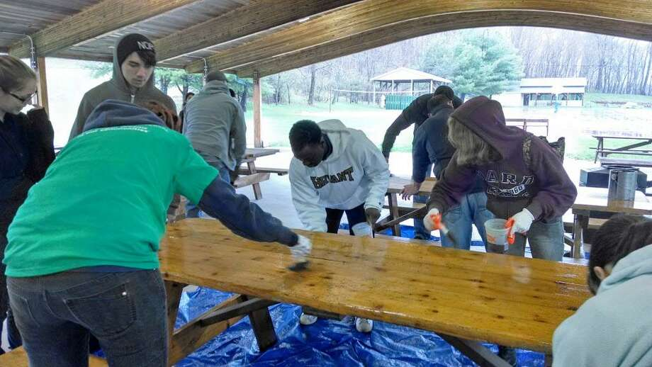 Members of the Middlesex United Way Young Leaders Society volunteer at Camp Ingersoll in Portland. Photo: Contributed Photo