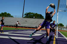Port Neches-Groves goalkeeper Libbie LeJeune makes a save during practice for the team's upcoming playoff game.Photo taken Tuesday 4/10/18Ryan Pelham/The Enterprise
