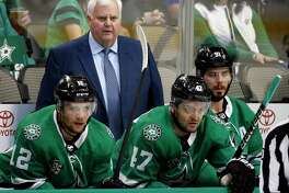 Dallas Stars head coach Ken Hitchcock, center Radek Faksa (12), right wing Alexander Radulov (47) and center Tyler Seguin (91) watch during the first period of an NHL hockey game against the Philadelphia Flyers in Dallas, Tuesday, March. 27, 2018. (AP Photo/Michael Ainsworth)