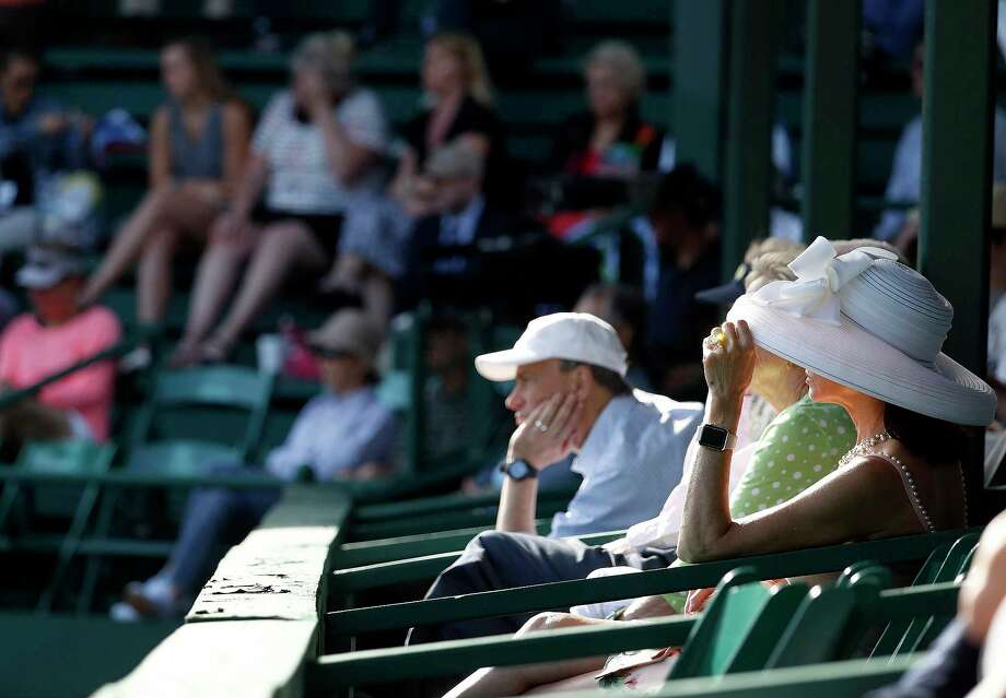 Donning hats to protect against the harsh evening sun Wednesday, fans watch Guido Pella play Sam Querrey. Photo: Karen Warren / © 2018 Houston Chronicle