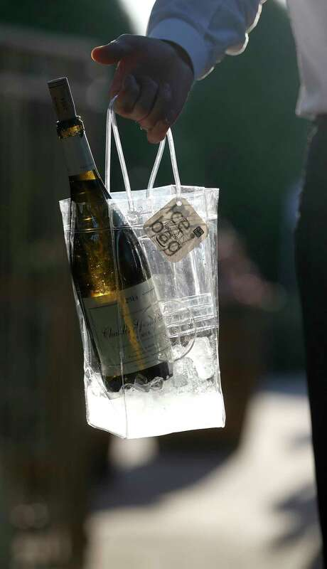 A huge hit with adults during the tournament is the portable wine in a fancy ice bag. Photo: Karen Warren / © 2018 Houston Chronicle