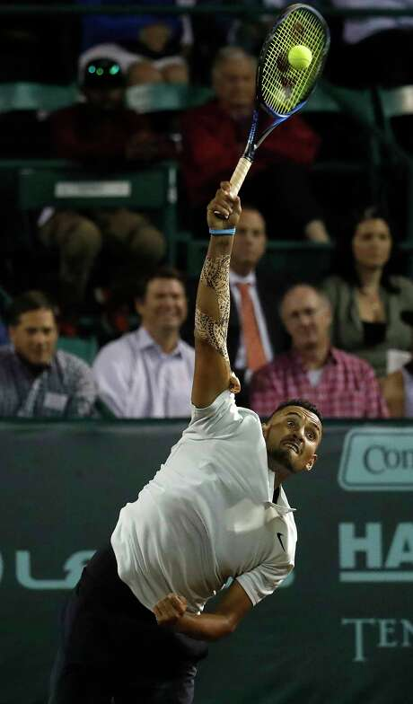 With a determined look, Nick Kyrgios serves to Bjorn Fratangelo during their Wednesday match. Kyrgios blasted 21 aces in his three-set victory. Photo: Karen Warren / © 2018 Houston Chronicle