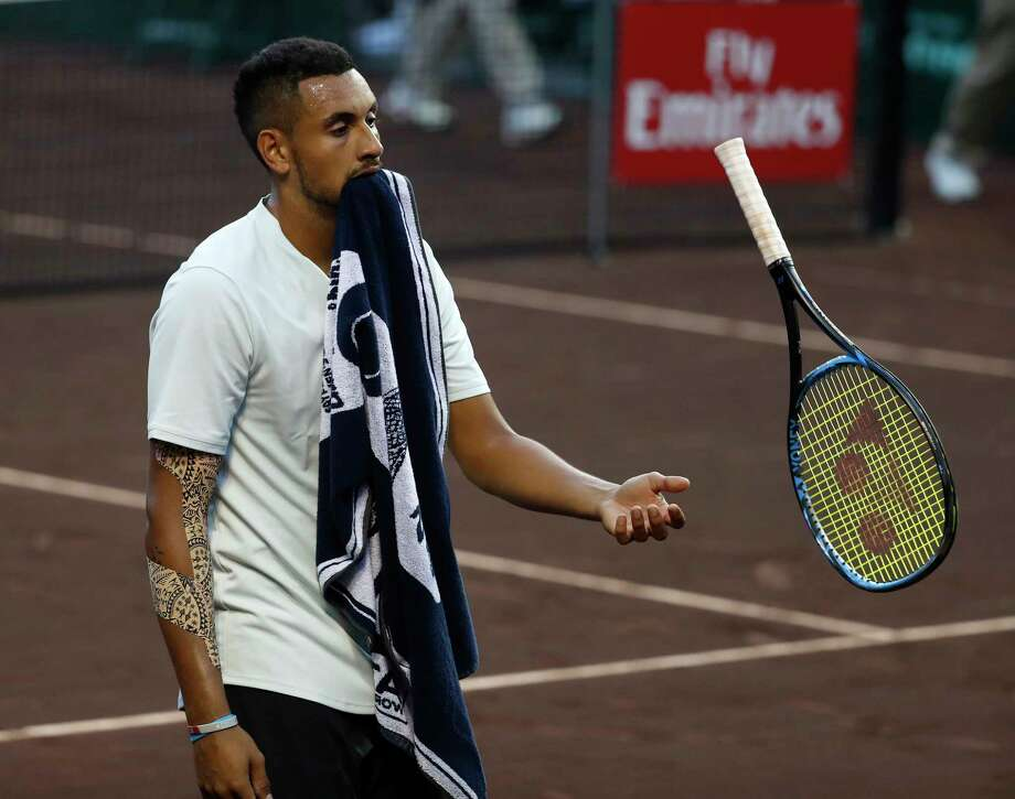 As he changes sides during his match against Bjorn Fratangelo, Nick Kyrgios unwinds a bit. Photo: Karen Warren / © 2018 Houston Chronicle