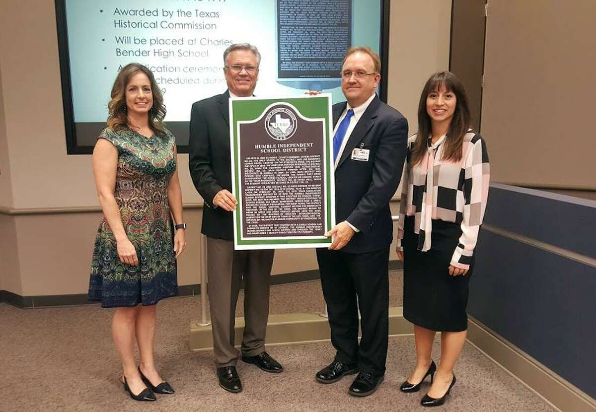 In honor of Humble ISD?'s centennial, the school district was awarded with a Texas Historical Marker that will be placed at the old Charles Bender High School campus in Humble. The announcement was made during the Humble ISD school board meeting on April 10. Right to left: Angela Conrad, school board president; Norman Funderburk, Humble city council member; Rob Meaux,student information systems coordinator for Humble ISD; Elizabeth Fagen, Humble ISD superintendent.