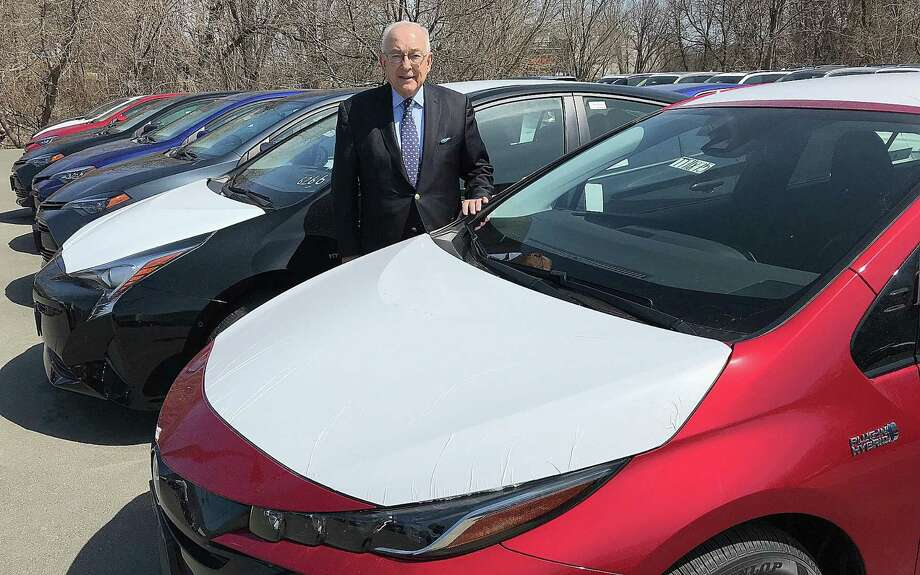 Greenwich resident Harold Tananbaum, owner of Greentree Toyota in Danbury, Conn., stands among a row of fuel-efficient Prius cars on his lot on Wednesday, April 11, 2018. Photo: Chris Bosak / Hearst Connecticut Media / The News-Times