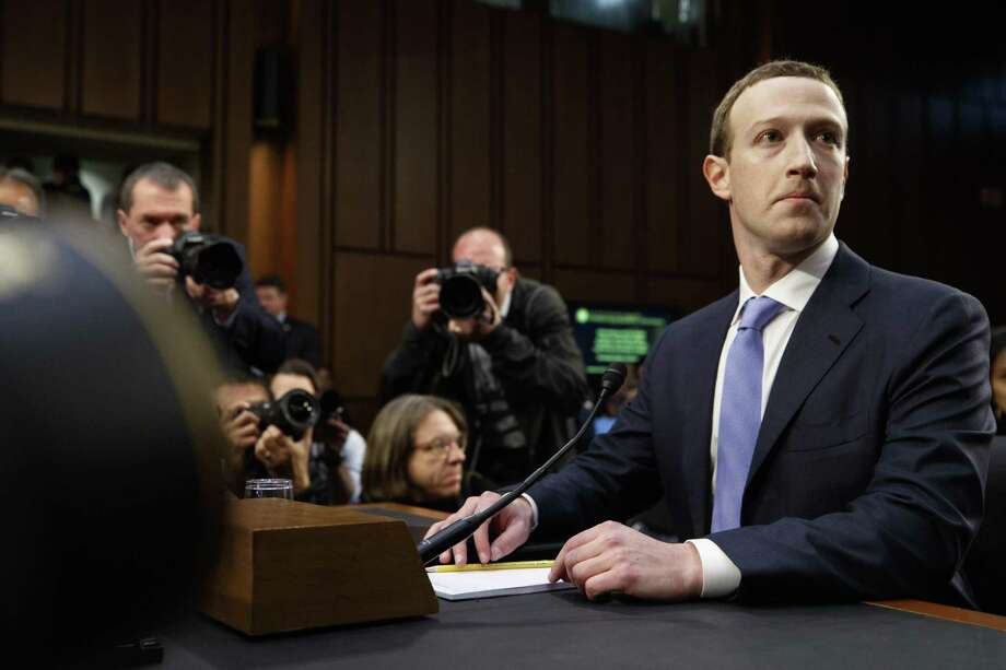 Mark Zuckerberg, the chief executive of Facebook, answers questions during a hearing at the Senate Hart office building in Washington, April 10, 2018. While members of both parties said Silicon Valley needed to be reigned in, the push for new privacy laws is likely to stall as lawmakers wrestle with technical complexities and constitutional issues. (Tom Brenner/The New York Times) Photo: TOM BRENNER / NYT / NYTNS