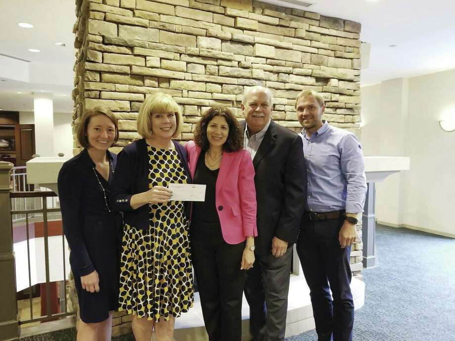 From left are Elena White, GHCF data and impact consultant; Bette Moser, executive director of HomeAid Houston; Renee Wizig-Barrios, GHCF SVP and chief philanthropy officer; David Weekley, chairman of David Weekley Homes; and Chris Yuko, director of BuildAid, showing the check for $5.5 million from the Hurricane Harvey Relief Fund (HHRF).