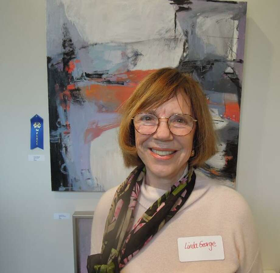 Linda George, of Darien, took home first place in the oils category for her work seen here at the Abstraction Exhibition at the Rowayton Arts Center. Photo: Contributed Photo