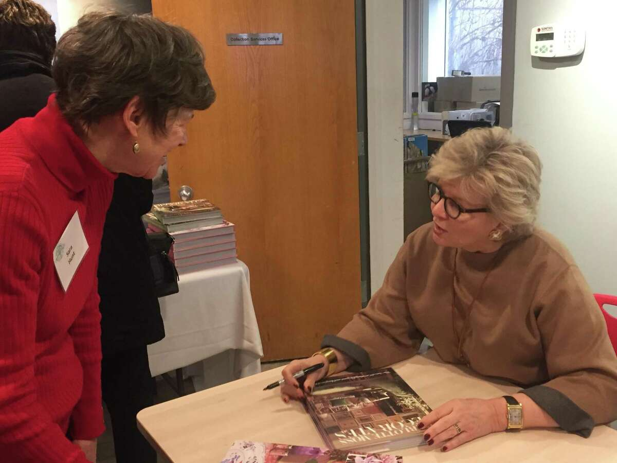 """The presentation """"Charlotte Moss Entertains: Setting the Table is Everyday Decorating"""" drew an audience of close to 160. Above, Moss, right, signs her new book, """"Charlotte Moss Entertains,"""" for Sarah Hunt."""