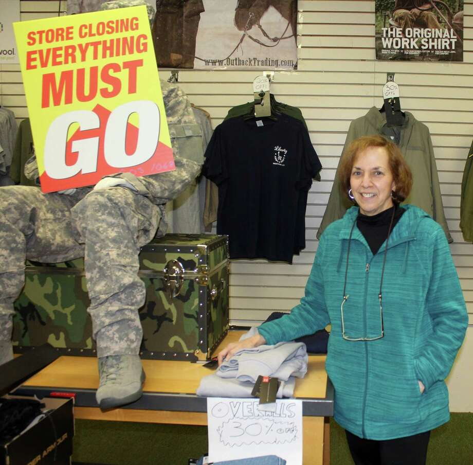 Liberty Army & Navy owner Eve Rothbard stands in her store on Post Road East in Westport. Photo: Sophie Vaughan / Hearst Connecticut Media / Westport News
