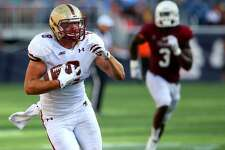 BOSTON - AUGUST 30: Boston College player (#8) Harold Landry heads for the endzone for a touchdown. UMass Vs. Boston College Football. (Photo by Jonathan Wiggs/The Boston Globe via Getty Images)