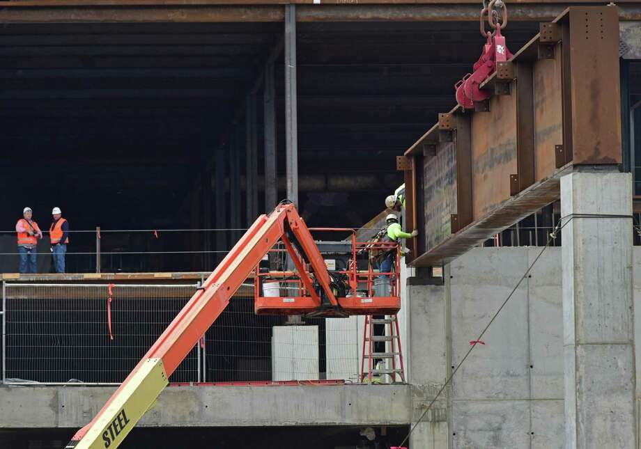Construction workers with General Growth Properties put in place the huge steel beams that will form the span over North Water Street connecting the two structures of The SoNo Collection mall Friday, March 30, 2018, in Norwalk, Conn. Photo: Erik Trautmann / Hearst Connecticut Media / Norwalk Hour