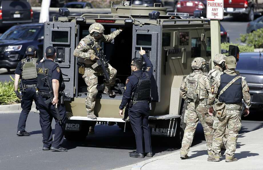 Armed law enforcement personnel exit an armored vehicle outside YouTube headquarters on April 3, 2018, in San Bruno, Calif., in response to an active shooter situation. Nasim Aghdam, the shooter, wounded three people with gunfire before killing herself. Mountain View police on Friday released body camera footage of thier interactions with her the morning of the shooting. (AP Photo/Marcio Jose Sanchez) Photo: Marcio Jose Sanchez / Associated Press