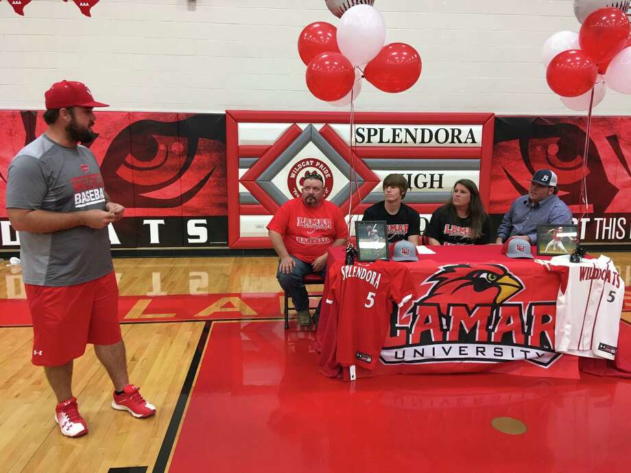Splendora baseball coach Chase Reneau, left, speaks as Dylan Johnson and his family look on during Johnson's signing ceremony with Lamar University Friday, April 13, 2018 in Splendora. Photo: Rob Tate