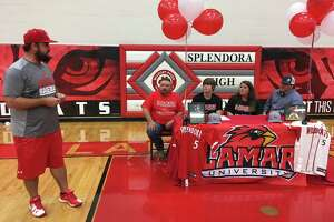 Splendora baseball coach Chase Reneau, left, speaks as Dylan Johnson and his family look on during Johnson's signing ceremony with Lamar University Friday, April 13, 2018 in Splendora.