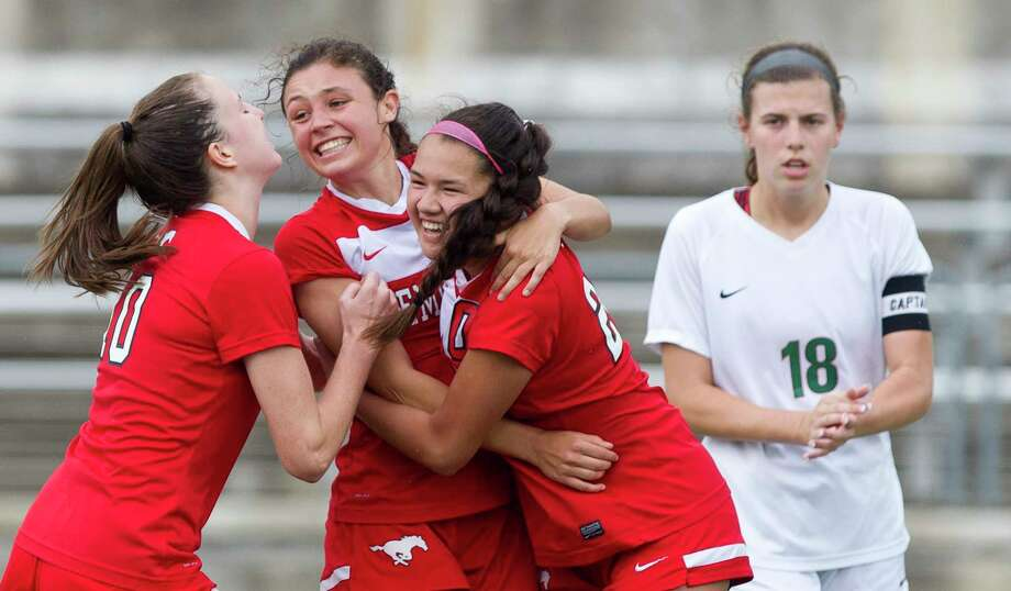 Memorial's Kelsey Hranicky, center, celebrates with teammates after scoring a penalty kick goal during the second period of a Region II-6A regional semifinal match at the Kelly Reeves Athletic Complex, Friday, April 13, 2018, in Round Rock. Photo: Jason Fochtman, Houston Chronicle / © 2018 Houston Chronicle