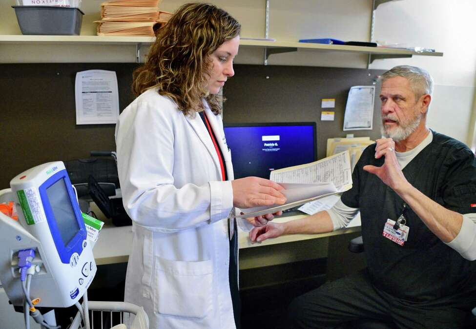 Dr. Melissa Weimer, left, consults with RN Francis Lanktree in the new ambulatory detox program at St. Peters Hospital Thursday Feb. 1, 2018 in Albany, NY. (John Carl D'Annibale/Times Union)