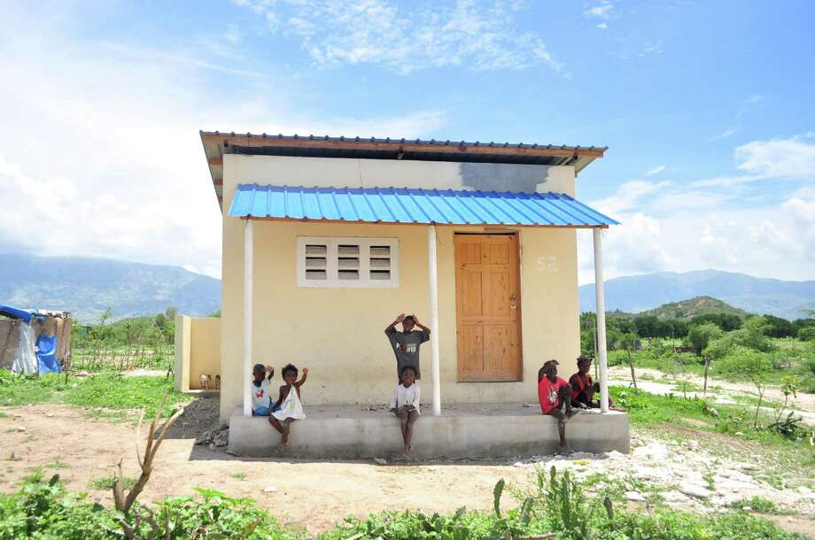 William Pitt and Julia B. Fee Sotheby's International Realty has partnered with New Story, a 501c3 non-profit, to transform lives by building homes in Haiti. Photo: Contributed Photo /New Story