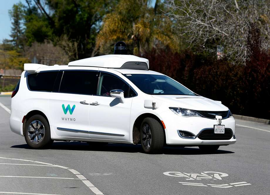 A Waymo self-driving car, with a backup driver behind the wheel, on a residential street in Mountain View. The company has now applied for a permit to test cars with no backup driver inside on California streets. Photo: Paul Chinn / The Chronicle