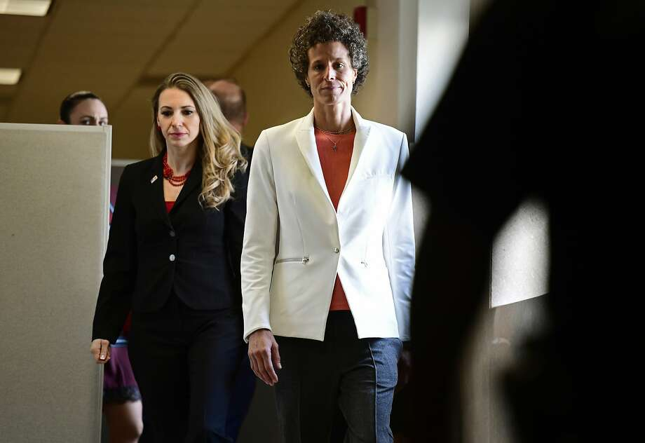 Andrea Constand (center) walks during a break in testimony at Bill Cosby's trial in Norristown, Pa. Constand says Cosby knocked her out with pills and then sexually assaulted her. Photo: Corey Perrine / Associated Press