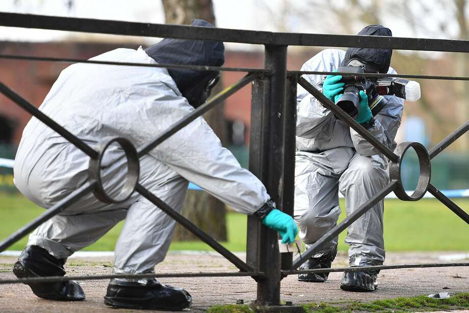 Investigators took photographs last month after swabbing railings in Salisbury, southern England. Photo: Ben Stansall / AFP / Getty Images