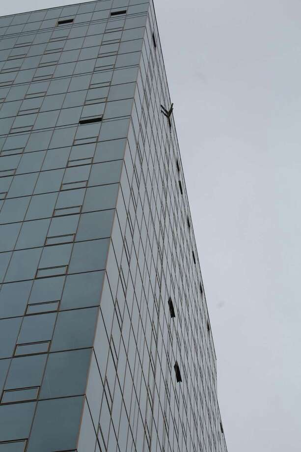 A pulley cable broke and fell Friday, April 13, 2018 from the twenty-second floor of a new 280-foot tower on the corner of Atlantic Street and Tresser Boulevard. Photo: Barry Lytton / Hearst Connecticut Media / Connecticut Post