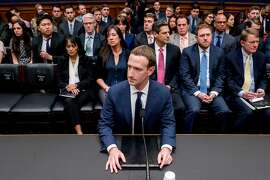 FILE- In this Wednesday, April 11, 2018, file photo, Facebook CEO Mark Zuckerberg arrives to testify before a House Energy and Commerce hearing on Capitol Hill in Washington. Zuckerberg repeatedly assured lawmakers Tuesday and Wednesday that he didn't believe the company violated its 2011 agreement with the Federal Trade Commission to overhaul its privacy practices. (AP Photo/Andrew Harnik, File)