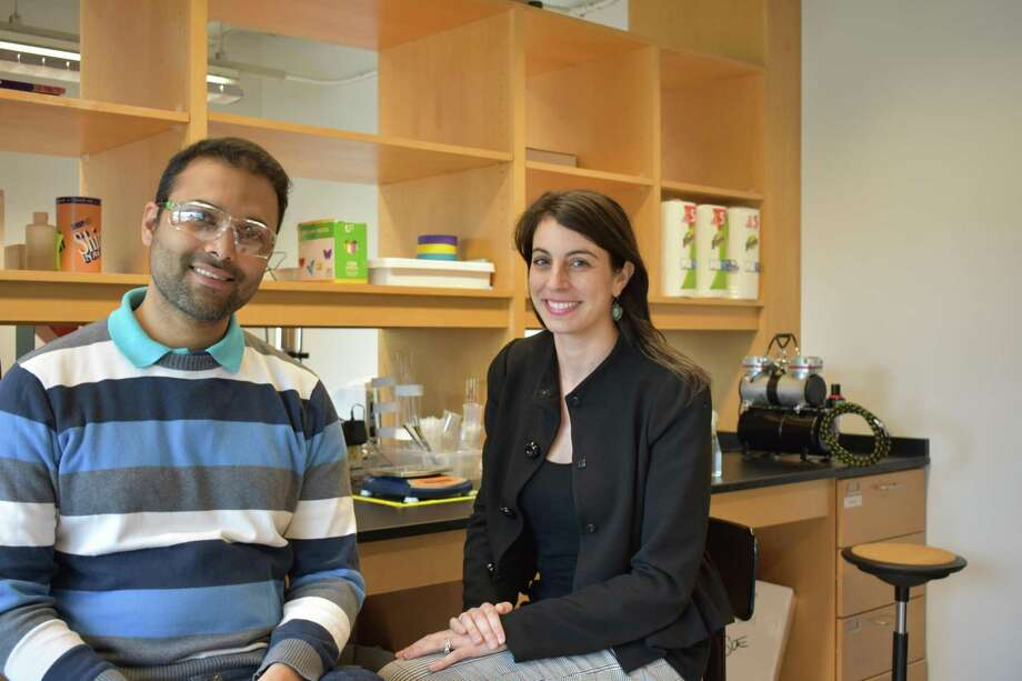 Melissa Fensterstock, president of Landsdowne Labs, with Ravi Vasudevan in lab space the startup is using at Fairfield University to develop coatings for button batteries to prevent injuries if accidentally ingested by children, as well as medical adhesive tapes that can be removed without damage to the skin. Photo: Alexander Soule / Hearst Connecticut Media / Stamford Advocate