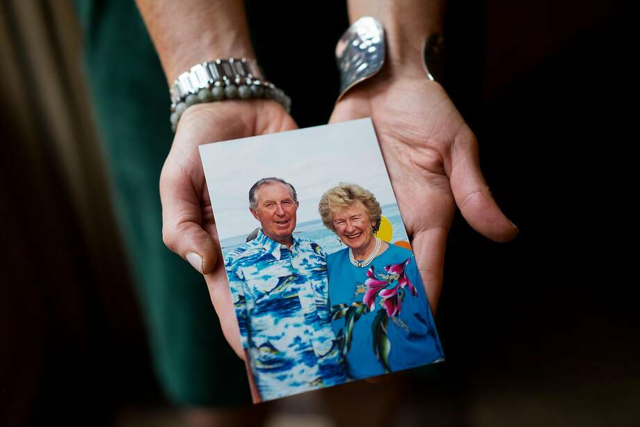 """Michaela """"Mikey"""" Hoag holds a photograph of her parents. Her mother has Alzheimer's, and her father passed away from the disease. Hoag founded the Part the Cloud gala, which has raised millions for the Alzheimer's Association. Photo: James Tensuan / Special To The Chronicle"""