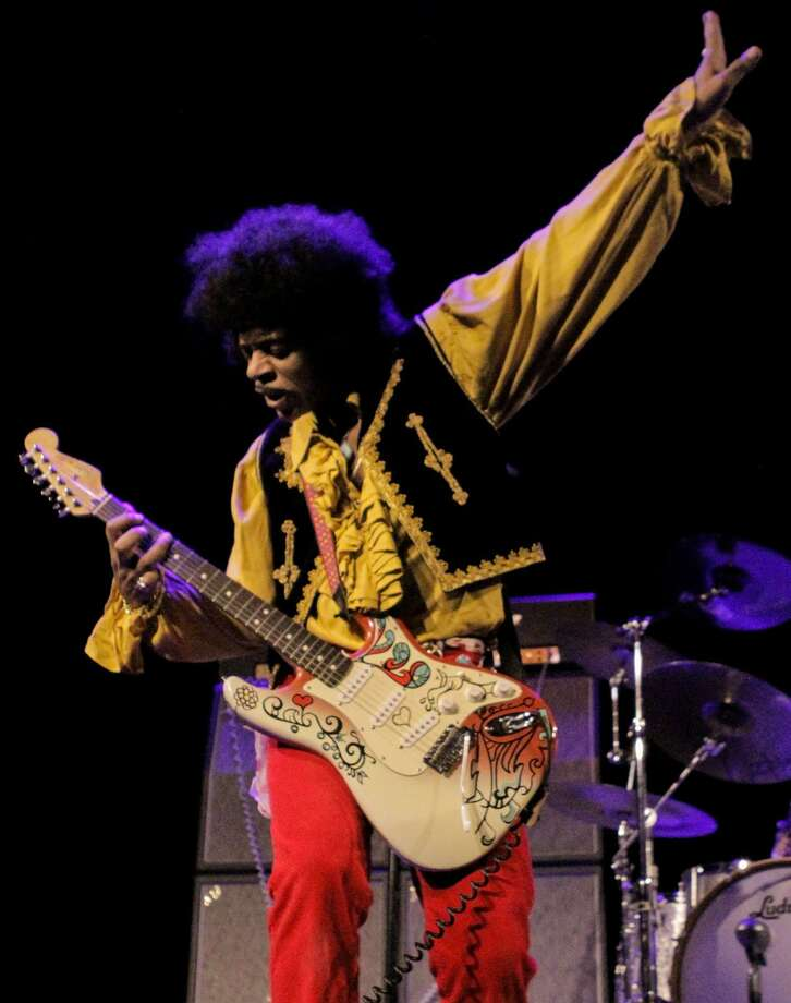 Kiss The Sky, featuring left-handed guitar virtuoso Jimy Bleu, performs a tribute to Jimi Hendrix at Danbury's Palace Theatre on April 28. Photo: Michael Vechesky / Contributed Photo