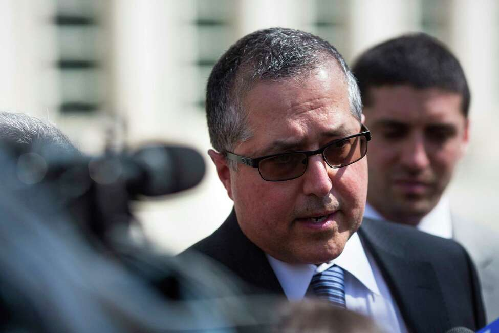 Attorney Mark Agnifilo representing Keith Raniere, speaks following Raniere's arraignment in federal court on Friday, April 13, 2018, in New York .