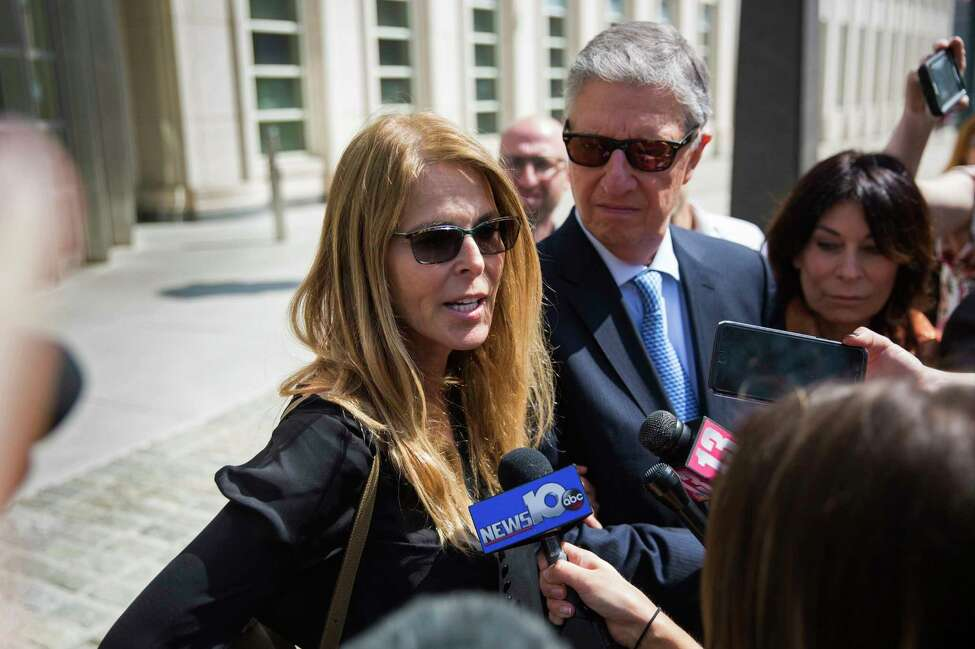 Actress Catherine Oxenberg, left, with Stanley Zareff and Toni Natalie, talks to the press following the arraignment of NXIVM leader Keith Raniere in federal court on Friday, April 13, 2018, in New York. Oxenberg's daughter India has been named as a co-conspirator in a criminal complaint against cult leader Keith Raniere.
