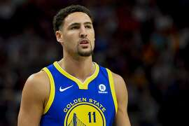Golden State Warriors guard Klay Thompson (11) looks on in the first half of an NBA basketball game against the Utah Jazz Tuesday, April 10, 2018, in Salt Lake City. (AP Photo/Alex Goodlett)