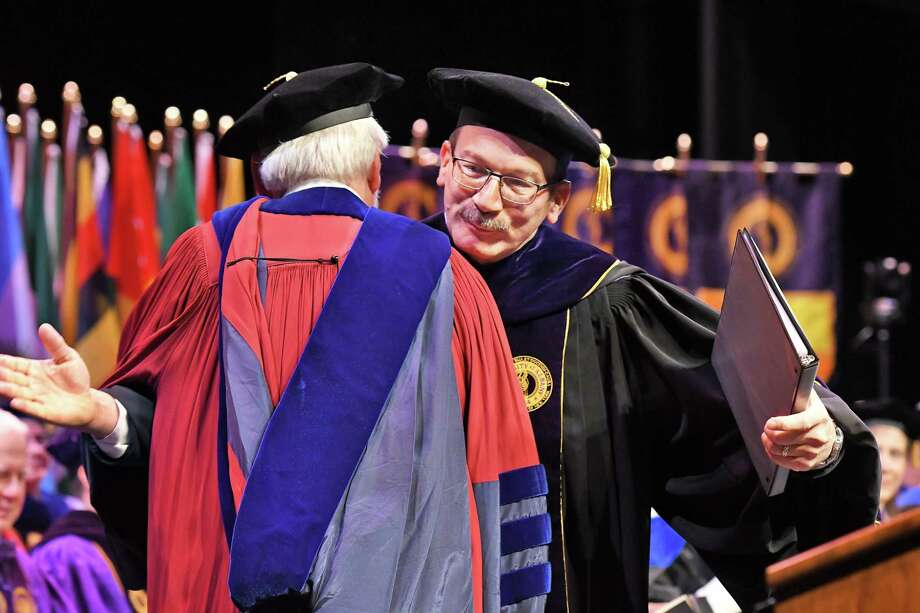 Dr. Havid‡n Rodr'guez, right, embraces Provost James Stellar, Ph.D.,during Rodr'guez's inauguration as the 20th President of the University at Albany in a ceremony at UAlbany Friday April 13, 2018 in Albany, NY.  (John Carl D'Annibale/Times Union) Photo: John Carl D'Annibale, Albany Times Union / 20043495A