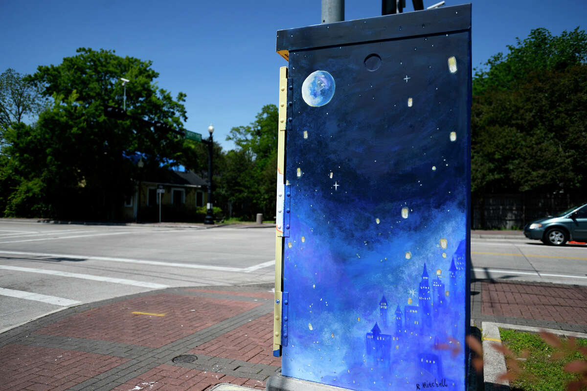 The sun, moon and stars featured on a traffic control box at the corner of Calder Avenue and 23rd Street painted by Rhonda Mitchell. Photo taken Wednesday 4/11/18 Ryan Pelham/The Enterprise