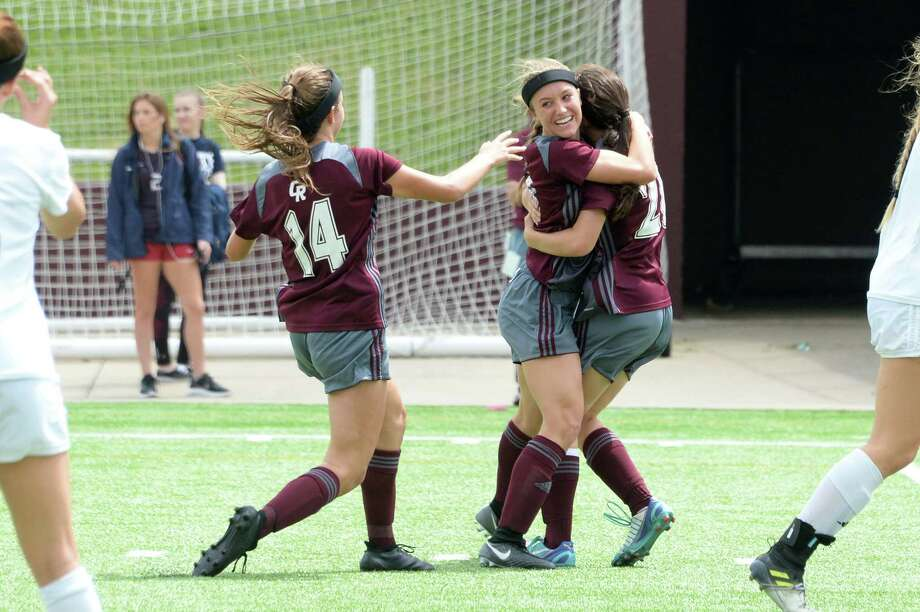 Forward Ali Russell (10) of Cinco Ranch reacts after scoring the Cougars' second goal during the second half of a 6A-III regional semifinal soccer playoff between the Cinco Ranch Cougars and the Clear Springs Chargers on Friday, April 13, 2018 at Abshier Stadium, Deer Park, TX. Photo: Craig Moseley, Houston Chronicle / ©2018 Houston Chronicle