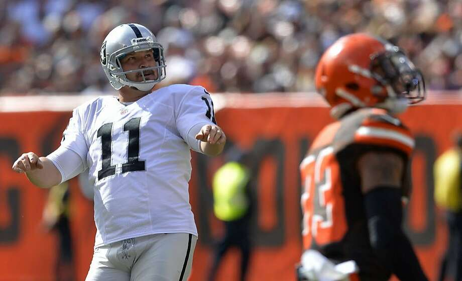 Oakland Raiders kicker Sebastian Janikowski (11) watches the ball after booting a 35-yard field goal in the second half of an NFL football game against the Cleveland Browns, Sunday, Sept. 27, 2015, in Cleveland. (AP Photo/David Richard) Photo: David Richard / Associated Press