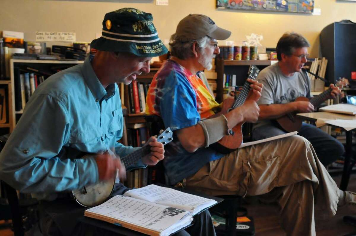 Ron Whitford of Jonesville, left, Ron Gordon of Schenectady, center, and John Gaudet of Albany, right, play ukulele at the Moon & River Cafe in Schenectady on Monday June 14, 2010. (Philip Kamrass / Times Union)