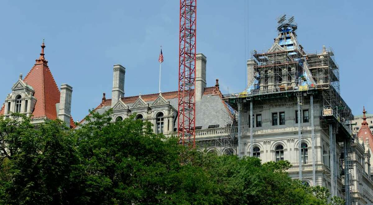 The fate of work on the Capitol roof is at issue as budget problems increase. (Skip Dickstein/Times Union)